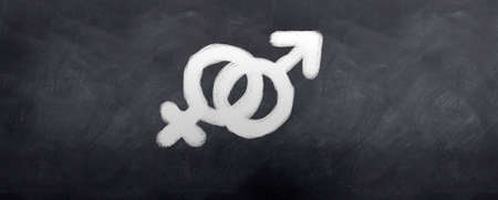 Male and female symbols Written in chalk on a blackboard