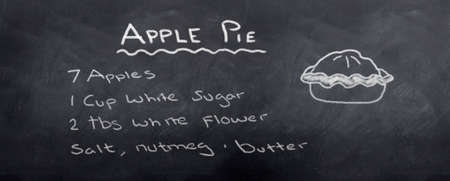 Apple pic recipe Written in chalk on a blackboard Archivio Fotografico