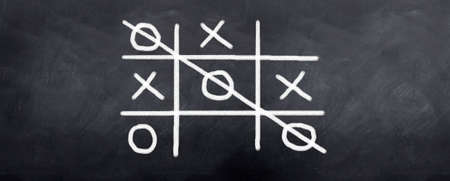 Xs and Os being played on a blackboard photo