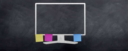 A bunch of post it notes are stuck to the computer monitor photo