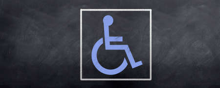 A blue wheelchair symbol is sketched on a blackboard photo