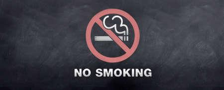 A no smoking sign symbol sketched on a blackboard