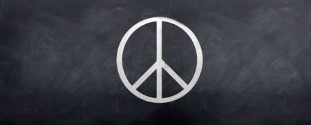 The Peace Symbol sketched on a blackboard Stock Photo - 6449094