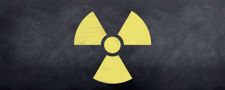 radioisotope: Radioactive symbol sketched on a blackboard