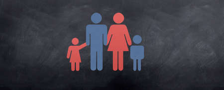 Family sign of mother, father, daughter and son on a chalkboard. photo