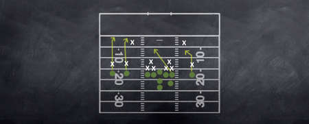 defensive: An American football attacking strategy being played out on the blackboard.