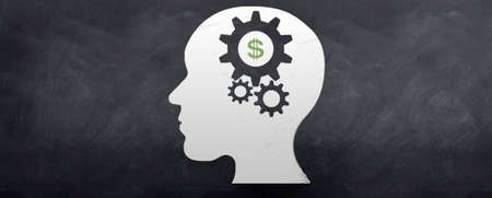gear head: A head sketched on a blackboard with gears turning inside the brain and a dollar symbol shown.