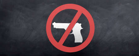 No Guns Allowed Sign sketched on the blackboard