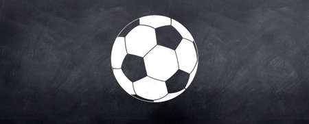 A round white soccer football is sketched on the blackboard