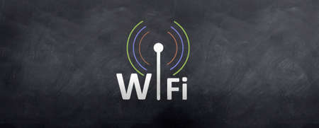 Wifi symbol and logo is drawn sketched on the blackboard Stock Photo