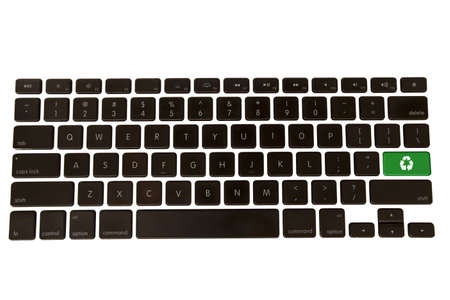 A keyboard isolated on a white background with a green environmental recycle symbol Stock Photo