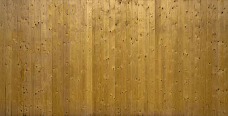 A photo of vertical wooden planks stacked making a nice background.