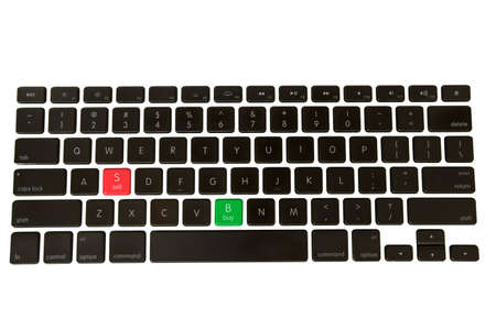 Green Buy and red Sell buttons on a isolated keyboard