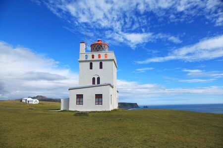 Dyrholaey Lighthouse on a sunny day in Iceland