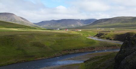 Beautiful icelandic panorama with river and houses