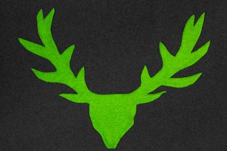 Green deer with antler made of felt Imagens