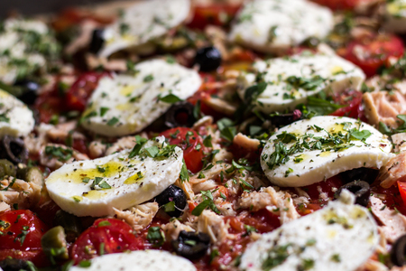 Pizza with Mozarella and tuna in detail Imagens