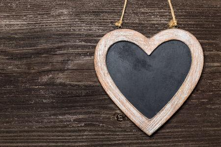 Chalkboard heart on wooden board Imagens