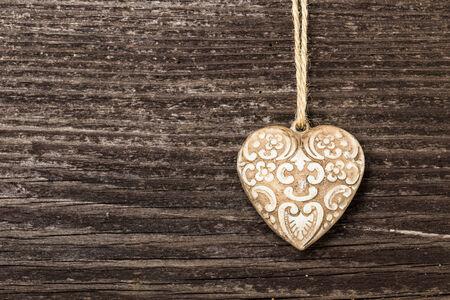 Pottery heart on wooden board