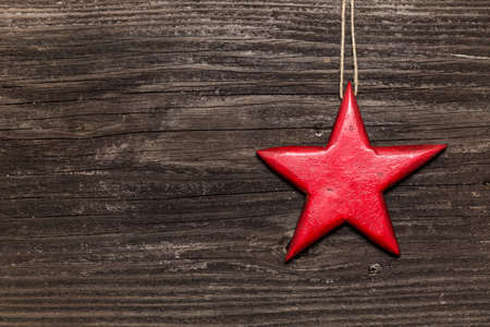 Red star on wooden board