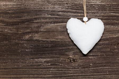 White heart on wooden board