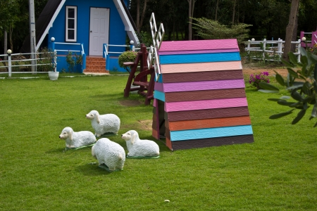 wooden windmill with sheep photo