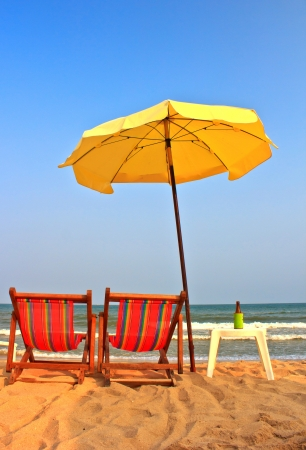 Beach chair and umbrella on tropical beach in Cha-Am ,Thailand photo