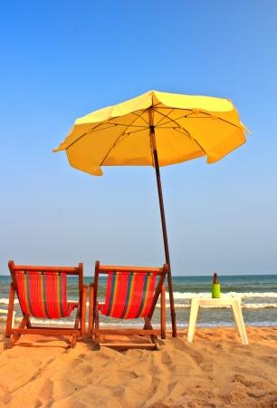 Beach chair and umbrella on tropical beach in Cha-Am ,Thailand