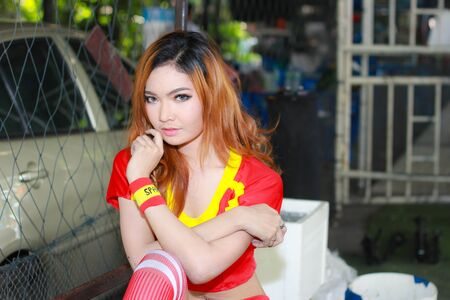 BANGKOK, THAILAND - JUNE 29, 2014  Unidentified model with Spain costume pose for promote World Cup 2014 in futsal park on June 29, 2014 in Bangkok, Thailand