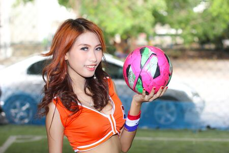 BANGKOK, THAILAND - JUNE 29, 2014  Unidentified model with Netherlands  costume pose for promote World Cup 2014 in futsal park on June 29, 2014 in Bangkok, Thailand