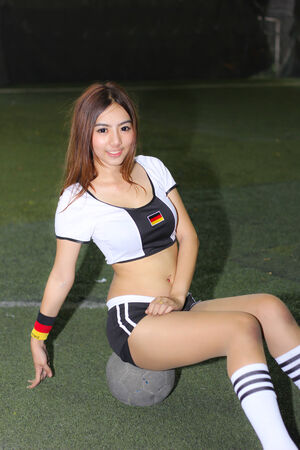 BANGKOK, THAILAND - JUNE 29, 2014  Unidentified model with Germany  costume pose for promote World Cup 2014 in futsal park on June 29, 2014 in Bangkok, Thailand