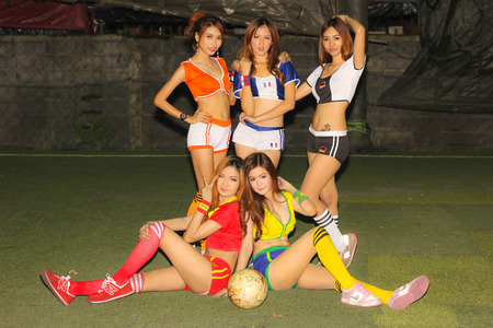 BANGKOK, THAILAND - JUNE 29, 2014  Unidentified model with Football costume pose for promote World Cup 2014 in futsal park on June 29, 2014 in Bangkok, Thailand