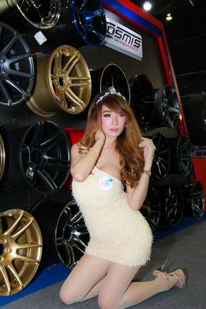 pp: Nonthaburi, Thailand - November 29, 2014: Unidentified pretty  with PP Superwheels pose in the 31th  Thailand International Motor Expo on November 29, 2014 in Nonthaburi, Thailand. Editorial