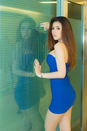 BANGKOK, THAILAND - FEBRUARY 15, 2014: Unidentified female presenter pose in Thailand Mobile Expo 2014 Showcase on February 15, 2014 in Bangkok, Thailand.