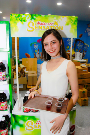 BANGKOK, THAILAND - JUNE 02, 2018: Unidentified female presenter pose in the THAIFEX - World of food asia 2018 on JUNE 02, 2018 in Bangkok, Thailand. Editorial