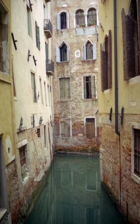 Quiet Venice canal surrounded by residential buildings