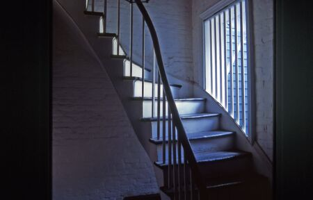A winding staircase in the French Quarter of New Orleans with window photo