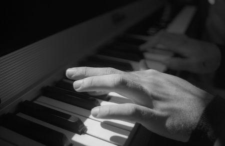 Hand Playing Piano Stock Photo