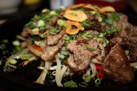 Japanese style chopped beef dish with bell peppers, green onions, and onion
