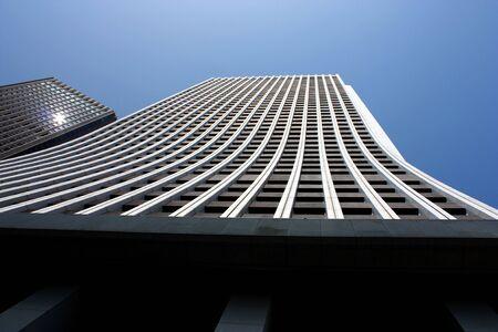 Looking up at Shinjuku Ward skyscraper wall in Tokyo