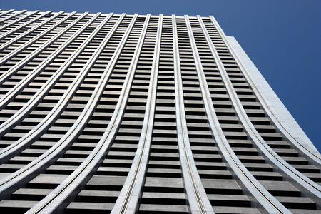 Looking upward at a skyscraper wall in Tokyos Shinjuku Ward Stock Photo