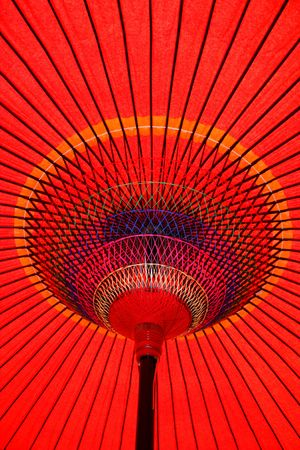 Looking up at a colorful red parasol in Japan