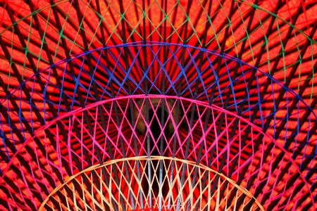 Looking up at detail of a colorful red parasol in Japan Stock Photo