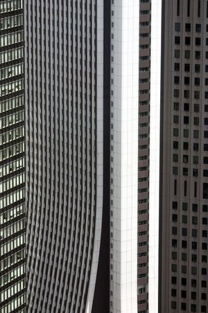 View of being closed in, or trapped, by a wall of buildings in Shinjuku ward of Tokyo, Japan.