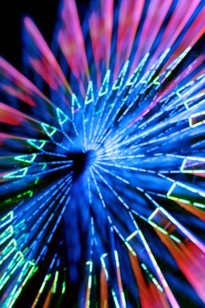 Abstract Blurred Spinning Ferris Wheel. Time lapse and zoom.
