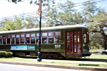 streetcar: Historic St Charles Avenue Streetcar whizzing by in Uptown New Orleans