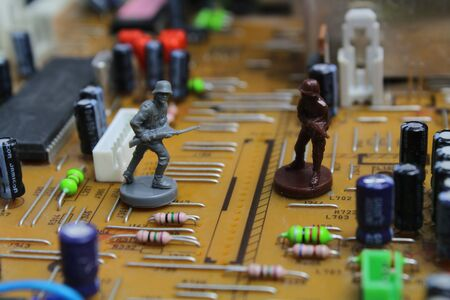 Toy weapons on a board represent cyber war