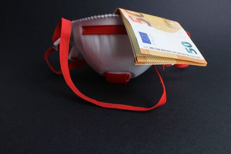 Protective mask with banknotes and black background