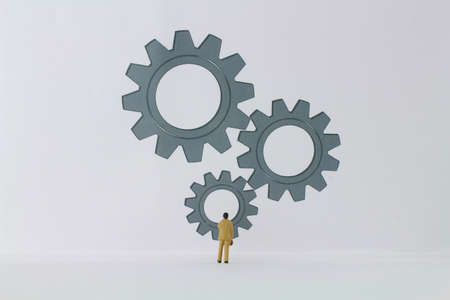 large gears with figures of business people in the foreground stands for innovation and business ideas