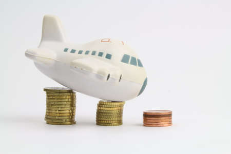 small plane on piles of coins